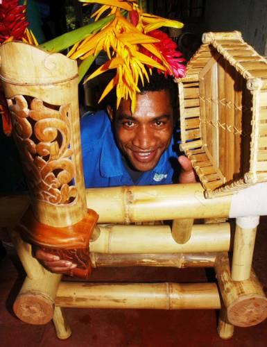 Maika Koroi, 23, displays a bamboo chair at Vusuya, Raralevu yesterday